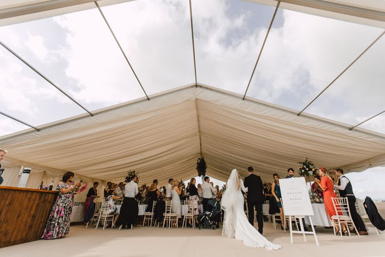 Marquee reception at Wales wedding venue in September with equestrian details