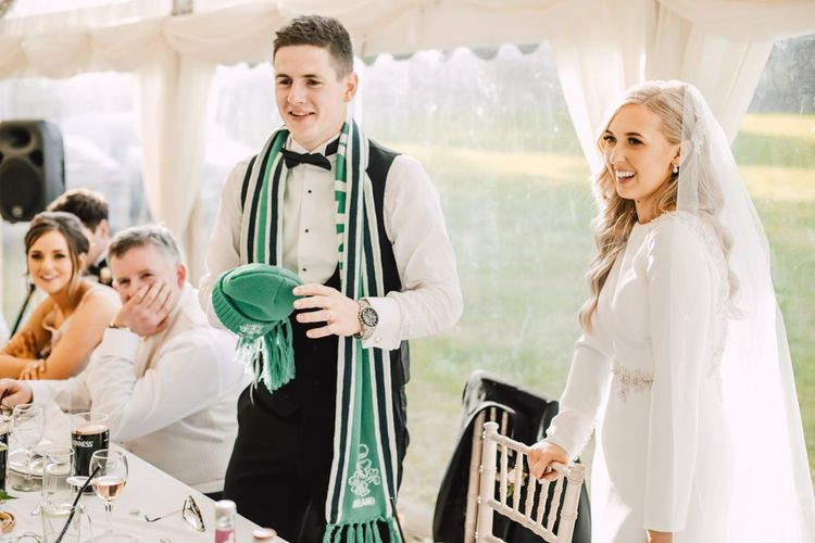 Bride and groom celebrate at their Wales wedding venue and marquee reception