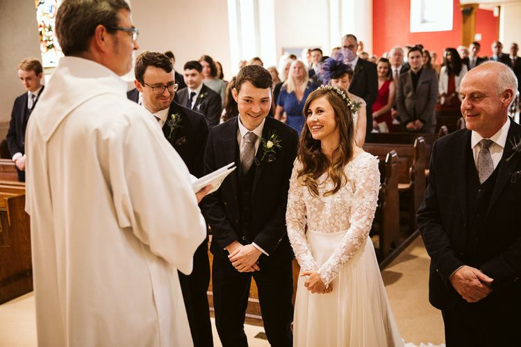 Wedding Ceremony with Bride in Long Sleeve Emma Beaumont Wedding Dress and Groom in Master Debonair Suit