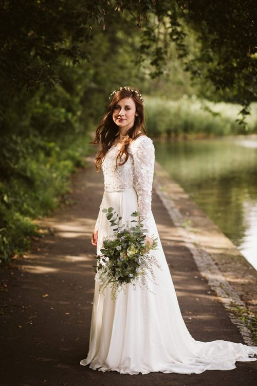 Bride in Applique Long Sleeve Emma Beaumont Wedding Dress by the Embankment