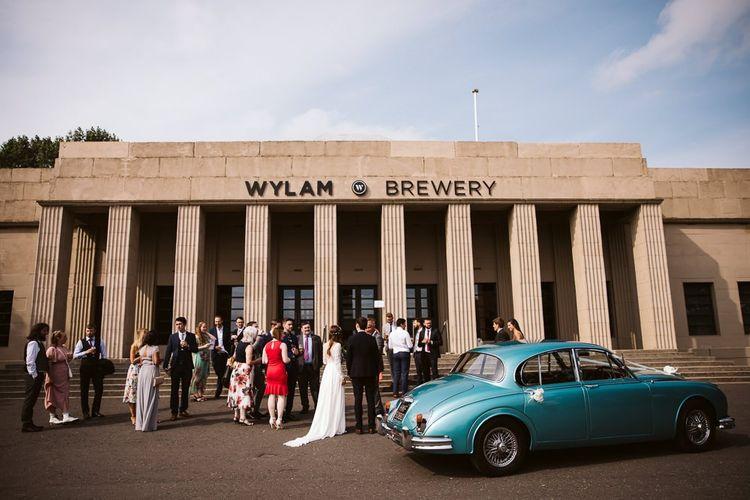 Wedding Guests and Vintage Blue Wedding Car Outside Wylam Brewery Wedding Venue in Newcastle