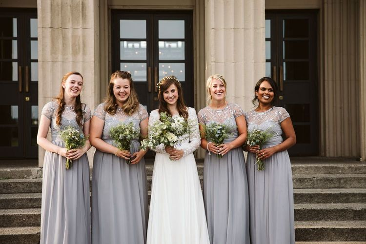Bridal Party Portrait with Bridesmaids in Grey Quiz Clothing Dresses and Bride in Emma Beaumont Wedding Dress