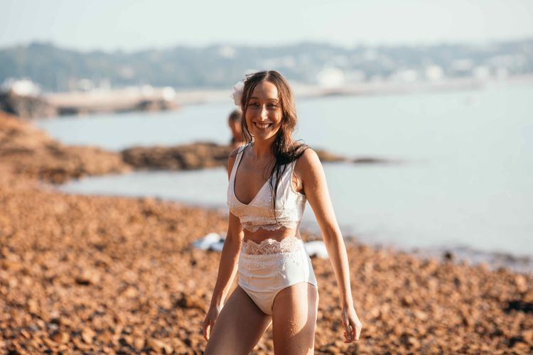 Bridal Lace Bikini | 7am Morning Sea Swim On The Wedding | Marquee in Jersey | Foliage Installations | Quints of Jersey Stationery | Bride Wears Enzoani | Images by Max Burnett