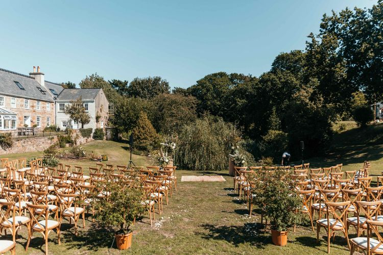 Outdoor Wedding Set Up. Marquee in Jersey. Foliage Installations. Stationery by Quints of Jersey. Bride Wears Enzoani. Photography by Max Burnett