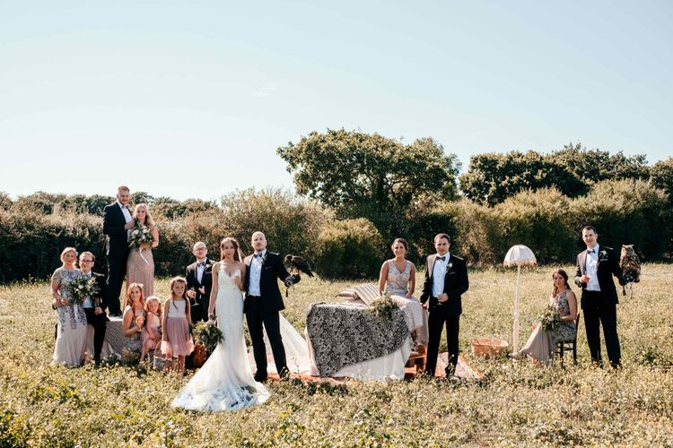 Falconry Club Comes to Wedding. Marquee in Jersey. Foliage Installations. Stationery by Quints of Jersey. Bride Wears Enzoani. Photography by Max Burnett
