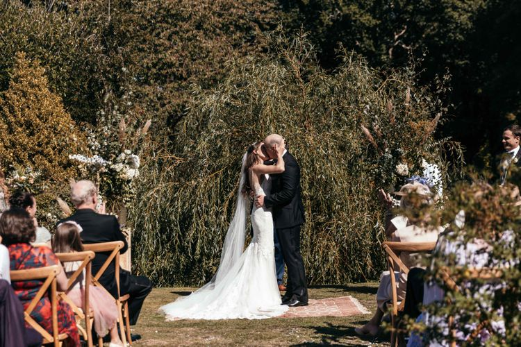 Ceremony Led By Grooms Friend. Enchanted Forest Theme | Florals and Foliage Installations by Eden by Claire | Quints of Jersey Stationery | Bride Wears Enzoani | Images by Max Burnett