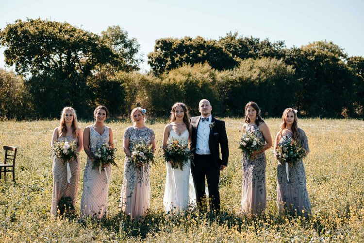 Stunning Bridesmaids Jewelled Dresses. Marquee in Jersey. Foliage Installations. Stationery by Quints of Jersey. Bride Wears Enzoani. Photography by Max Burnett