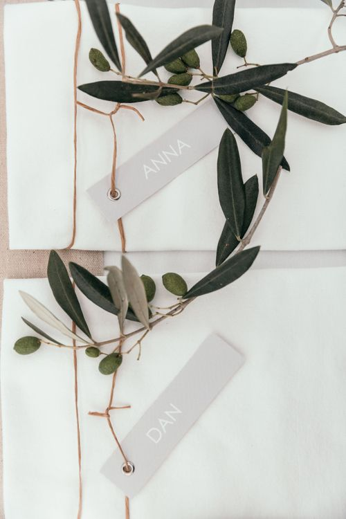Name Places. Marquee in Jersey. Foliage Installations. Stationery by Quints of Jersey. Bride Wears Enzoani. Photography by Max Burnett