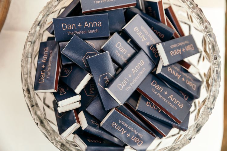 Personalised Matches Favours. Marquee in Jersey. Foliage Installations. Stationery by Quints of Jersey. Bride Wears Enzoani. Photography by Max Burnett