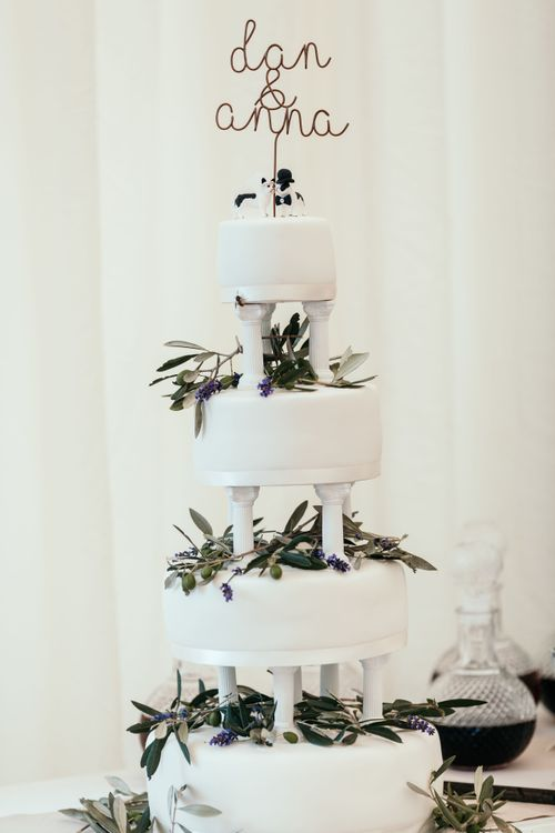 Marks and Spencer Plain White Iced Cake. Marquee in Jersey. Foliage Installations. Stationery by Quints of Jersey. Bride Wears Enzoani. Photography by Max Burnett