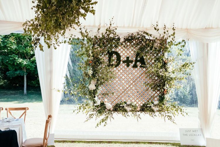 Monogrammed Floral Display Photo Wall. Enchanted Forest Theme | Florals and Foliage Installations by Eden by Claire | Quints of Jersey Stationery | Bride Wears Enzoani | Images by Max Burnett
