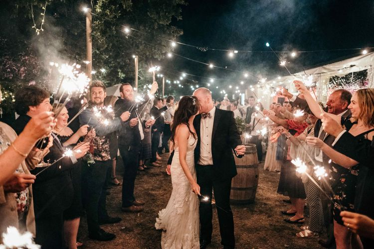 Sparklers On Wedding Exit. Marquee in Jersey. Foliage Installations. Stationery by Quints of Jersey. Bride Wears Enzoani. Photography by Max Burnett