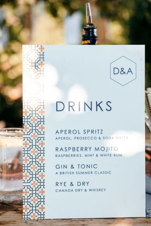 Drinks Menu, On The Day Stationery. Marquee in Jersey. Foliage Installations. Stationery by Quints of Jersey. Bride Wears Enzoani. Photography by Max Burnett