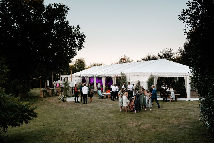 Marquee In The Evening. Enchanted Forest Theme . Florals and Foliage Installations by Eden by Claire | Quints of Jersey Stationery | Bride Wears Enzoani | Images by Max Burnett