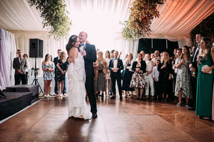 First Dance. Enchanted Forest Theme | Florals and Foliage Installations by Eden by Claire | Quints of Jersey Stationery | Bride Wears Enzoani | Images by Max Burnett