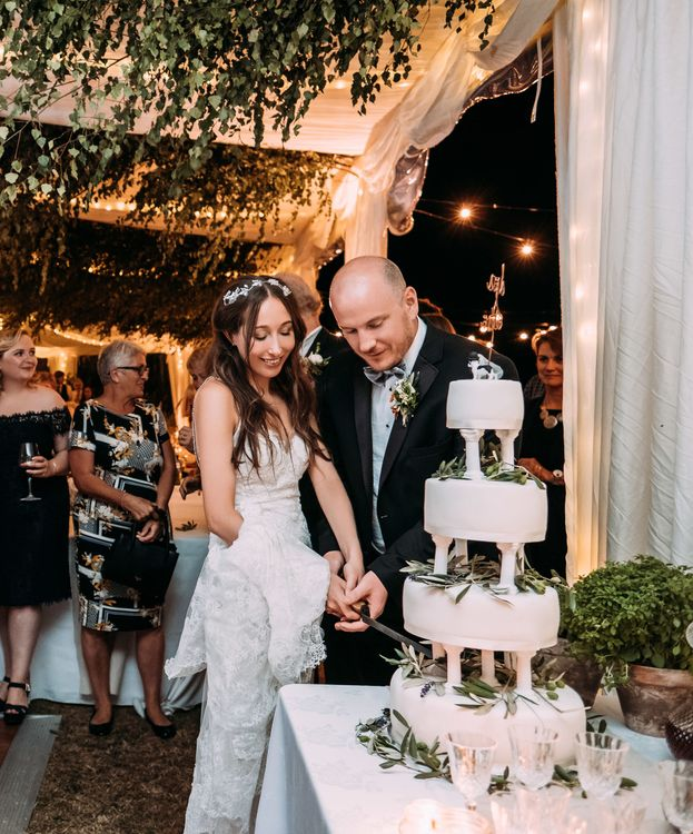 Marks and Spencer's Plain White Iced Wedding Cake. Marquee in Jersey. Foliage Installations. Stationery by Quints of Jersey. Bride Wears Enzoani. Photography by Max Burnett