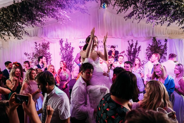 Wedding Dance. Lighting for Wedding. Marquee in Jersey. Foliage Installations. Stationery by Quints of Jersey. Bride Wears Enzoani. Photography by Max Burnett