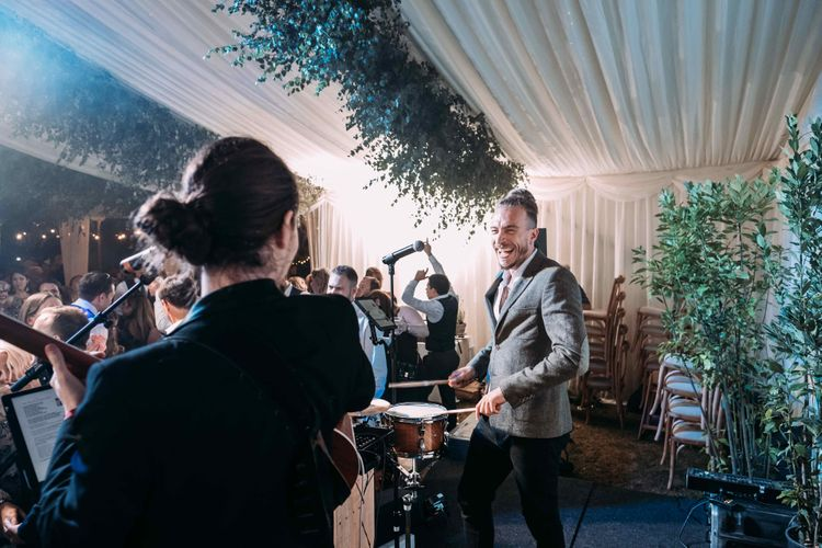 Marquee in Jersey. Foliage Installations. Stationery by Quints of Jersey. Bride Wears Enzoani. Photography by Max Burnett