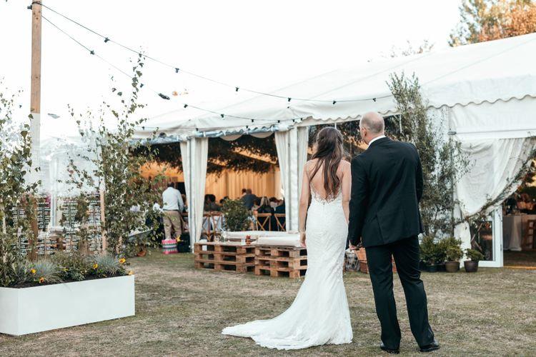 Enzoani Backless Dress. Marquee in Jersey. Foliage Installations. Stationery by Quints of Jersey. Bride Wears Enzoani. Photography by Max Burnett