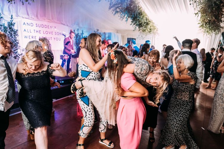 Epic Wedding Reception. Marquee in Jersey. Foliage Installations. Stationery by Quints of Jersey. Bride Wears Enzoani. Photography by Max Burnett