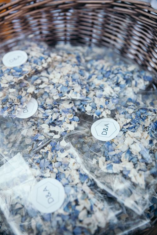 Blue and Cream Floral Confetti. Marquee in Jersey. Foliage Installations. Stationery by Quints of Jersey. Bride Wears Enzoani. Photography by Max Burnett