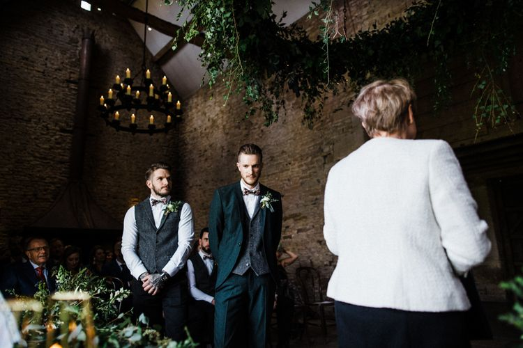 Groom Standing at the Altar in a Wool Waistcoat and Floral Bow Tie