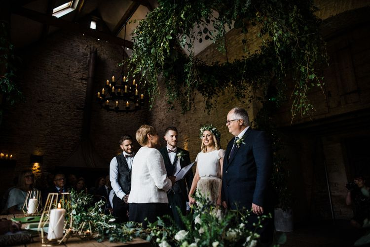 Wedding Ceremony at Stone Barn with Bride in Halfpenny London Swan Tulle Petal Bridal Skirt and Groom in Wool Suit and Bow Tie