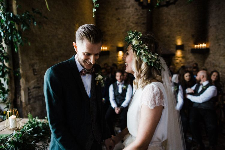 Wedding Ceremony at Stone Barn with Bride in Halfpenny London Swan Tulle Petal Skirt and Flower Crown and Groom in Wool Suit and Bow Tie