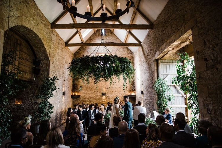 Wedding Ceremony at Stone Barn with Foliage Floristry Decor by Go Wild Flowers
