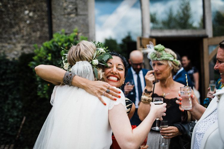 Bride being Embraced by Wedding Guests