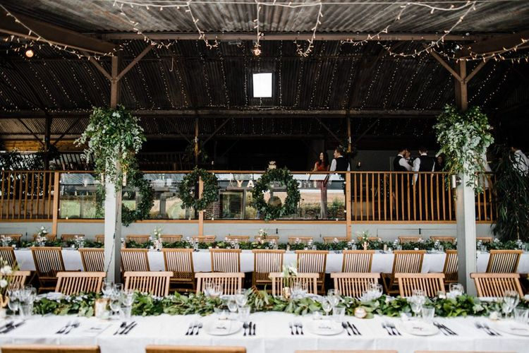 Green White and Gold Wedding Reception Decor at Cripps Stone Barn in Gloucestershire