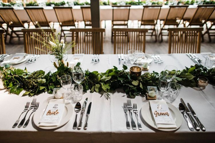 Place Setting with Foliage Centrepiece and Wooden Place Names