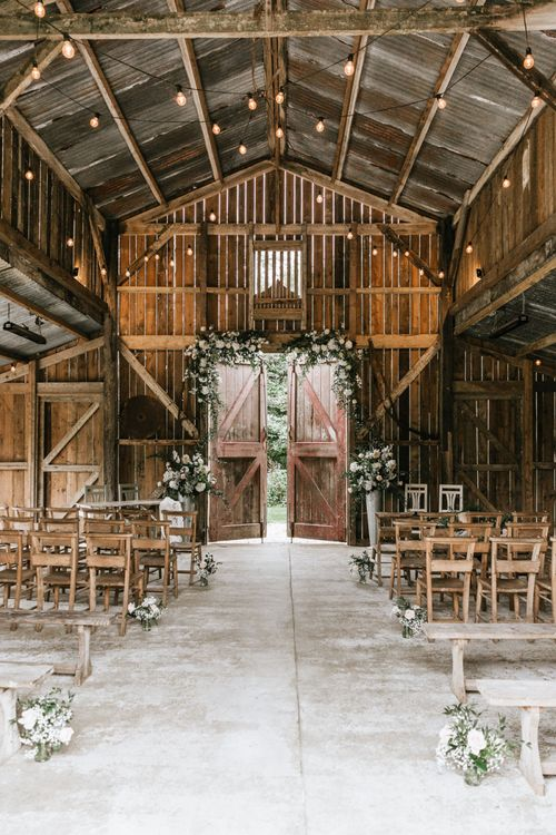 Travel themed wedding at Nancarrow Farm with rusty barn wedding ceremony