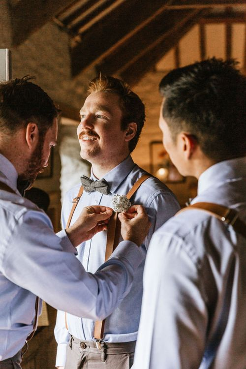Groom preparations for travel themed wedding