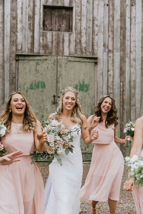Pink mid-length  bridesmaid dresses with flower crowns