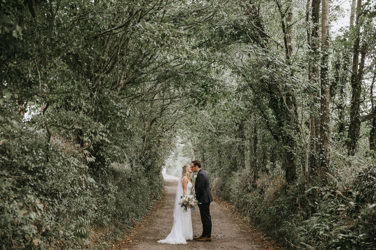 Bride and groom in the grounds of Cornwall wedding venue