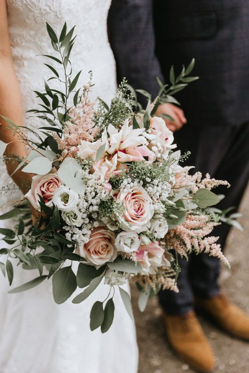 Blush bridal bouquet at travel themed wedding