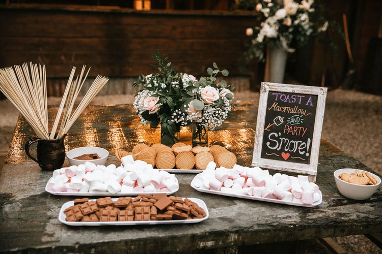 S'mores table at travel themed wedding
