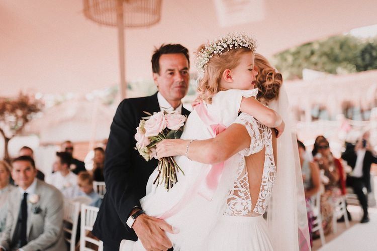 Wedding Ceremony | Bride in Yaki Ravid Gown | Groom in Armani Suit | Flower Girl Daughter with Gypsophila Flower Crown | Blush Pink & White Marbella Beach Wedding at El Chiringuito, Puente Romano |  Kino Ortega Photographer