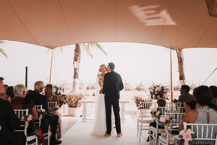 Wedding Ceremony | Bride in Yaki Ravid Gown | Groom in Armani Suit | Blush Pink & White Marbella Beach Wedding at El Chiringuito, Puente Romano |  Kino Ortega Photographer
