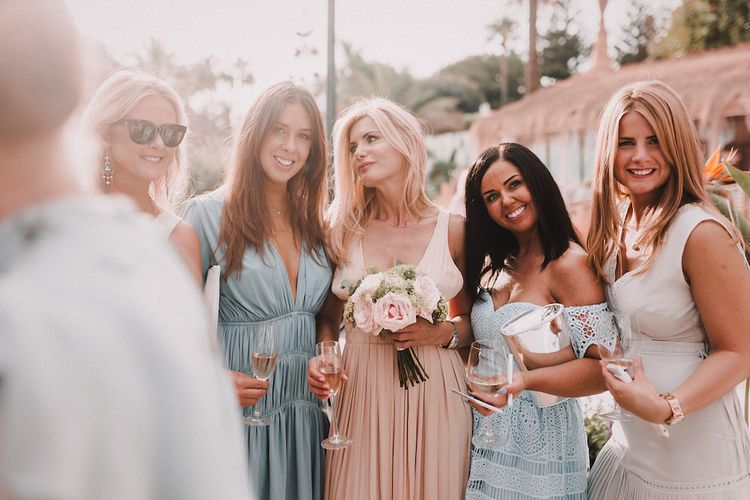 Wedding Guests | Blush Pink & White Marbella Beach Wedding at El Chiringuito, Puente Romano |  Kino Ortega Photographer