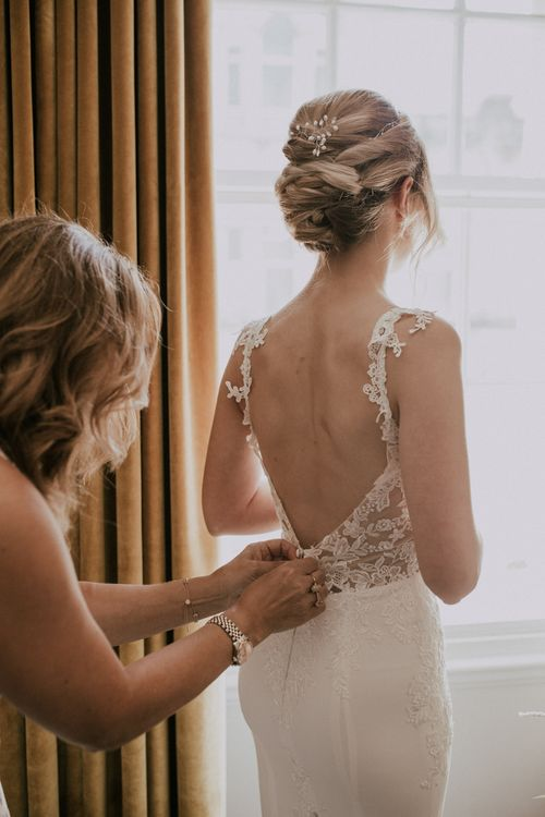 Bride In Low Backed Wedding Gown / Image By Nataly J Photography