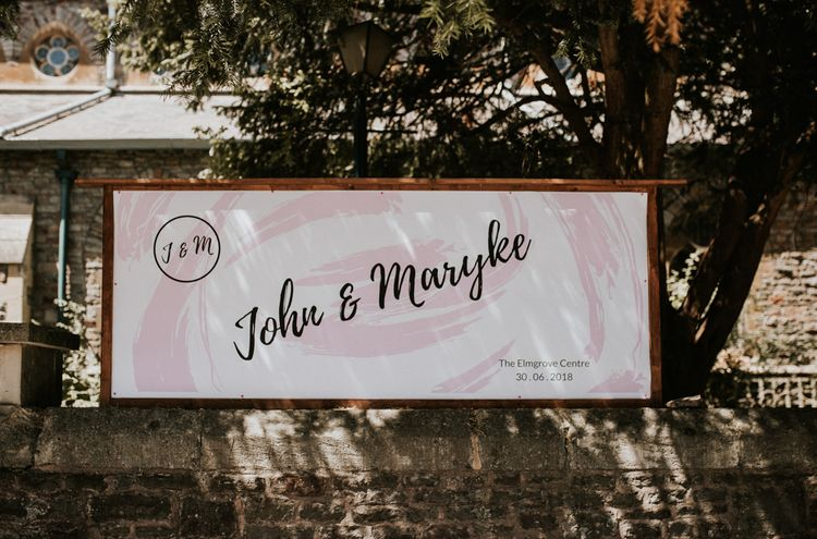 Pink Floral Wedding Sign / Image By Nataly J Photography