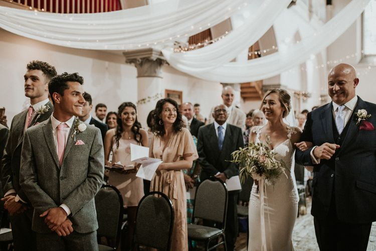Wedding Ceremony With White Drapes For Decor / Image By Nataly J Photography