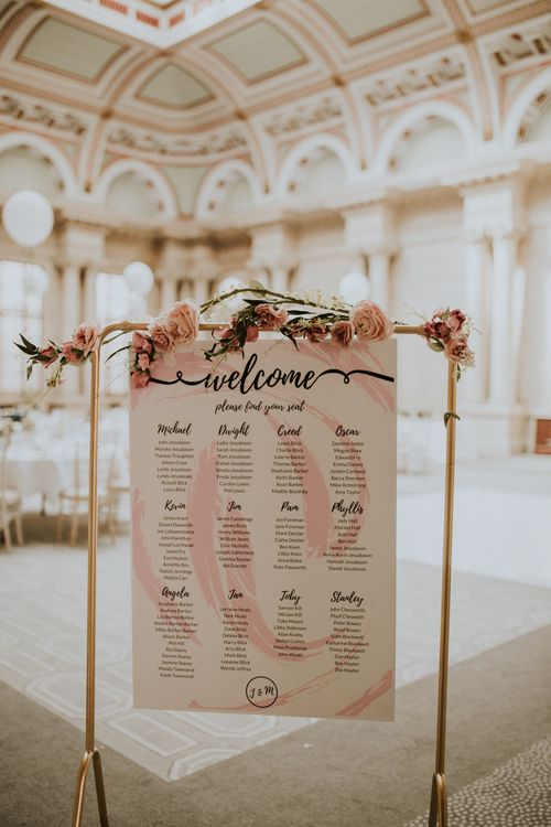 Metal Framed Table Plan For Wedding With Pink Flowers / Image By Nataly J Photography