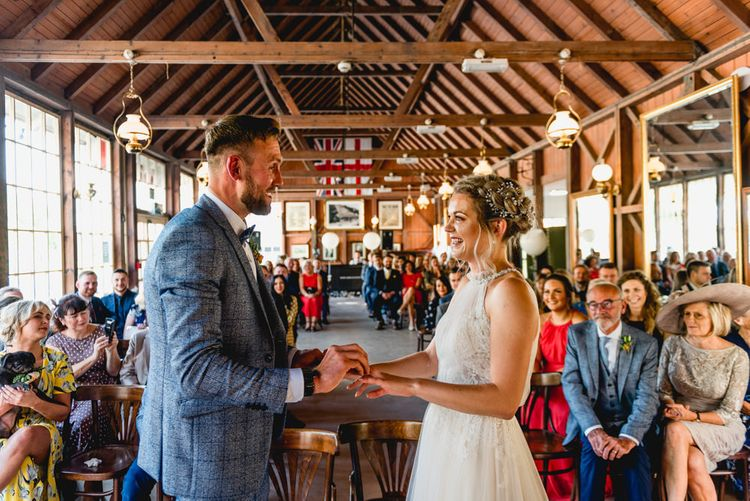 Wedding Ceremony | Bride in Halterneck Tulle Allure Bridal Wedding Dress | Groom in  Blue Check Moss Bros. Suit | Vintage Fairground at Blists Hill Victorian Town Museum in Ironbridge | Lisa Carpenter Photographer