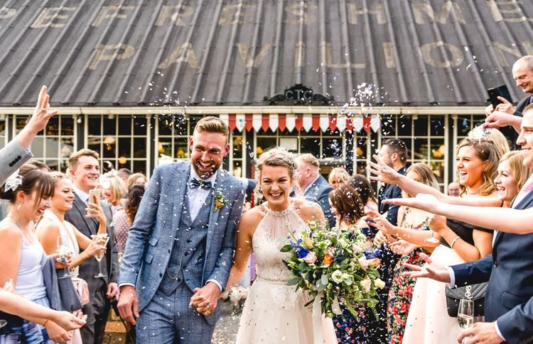 Confetti Moment | Bride in Halterneck Tulle Allure Bridal Wedding Dress | Groom in  Blue Check Moss Bros. Suit | Vintage Fairground at Blists Hill Victorian Town Museum in Ironbridge | Lisa Carpenter Photographer