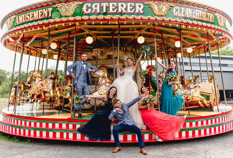 Wedding Party | Bridesmaids in Different Coloured Dresses | Bride in Halterneck Tulle Allure Bridal Wedding Dress | Groom in  Blue Check Moss Bros. Suit | Vintage Fairground at Blists Hill Victorian Town Museum in Ironbridge | Lisa Carpenter Photographer