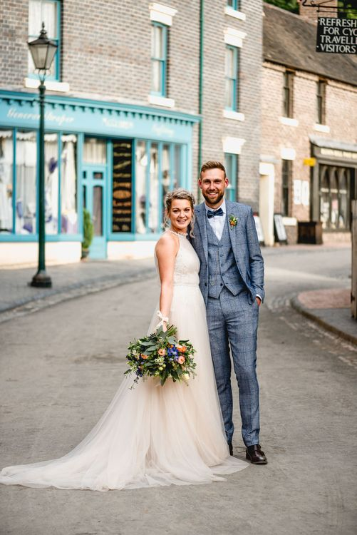 Bride in Halterneck Tulle Allure Bridal Wedding Dress | Groom in  Blue Check Moss Bros. Suit | Vintage Fairground at Blists Hill Victorian Town Museum in Ironbridge | Lisa Carpenter Photographer