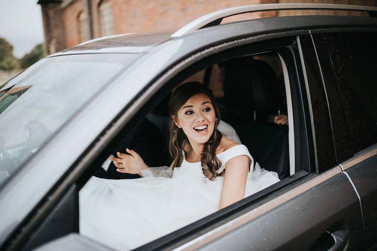 Bride arriving in the Wedding Car
